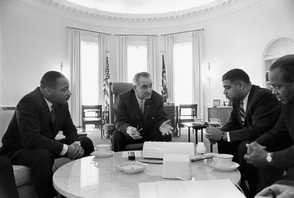 Lyndon B. Johnson sits with Civil Rights Leaders in the White House. One of Johnson's greatest legacies would be his staunch support of civil rights legislation. Photograph, January 18, 1964. Wikimedia.