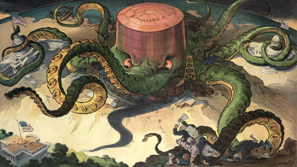 """Udo Keppler, """"Next!"""" (1904). Illustration shows a """"Standard Oil"""" storage tank as an octopus with many tentacles wrapped around the steel, copper, and shipping industries, as well as a state house, the U.S. Capitol, and one tentacle reaching for the White House. The only building not yet within reach of the octopus is the White House—President Teddy Roosevelt had won a reputation as a """"trust buster."""" Via Library of Congress (LC-USZCN4-122)."""