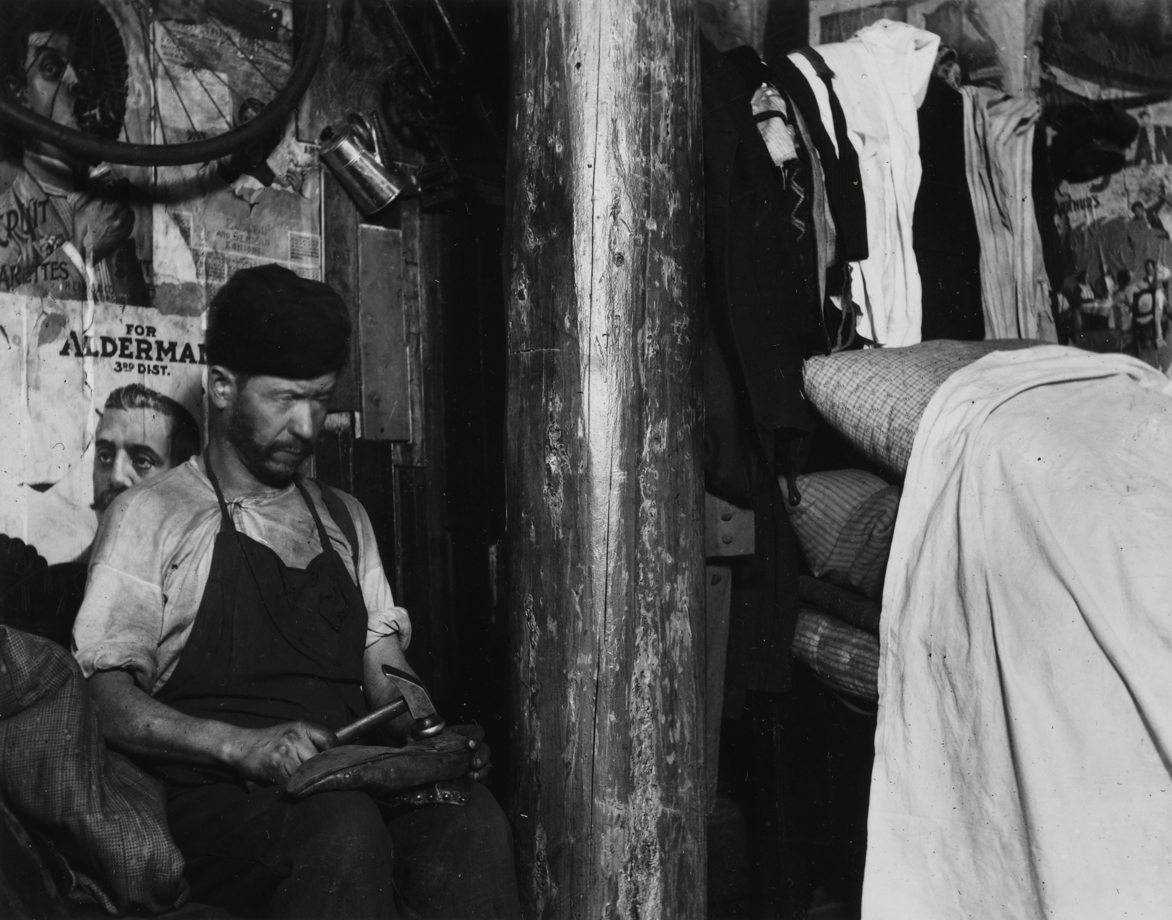 """Shoemaker Working in a house in the Yard of 219 Broome Street, Which the Landlord Built When the Sanitary Police Put him out of the Basement. Clatterpol Sticks Up Through his House. Rent $ 12 a Month."" Via Preus Museum"