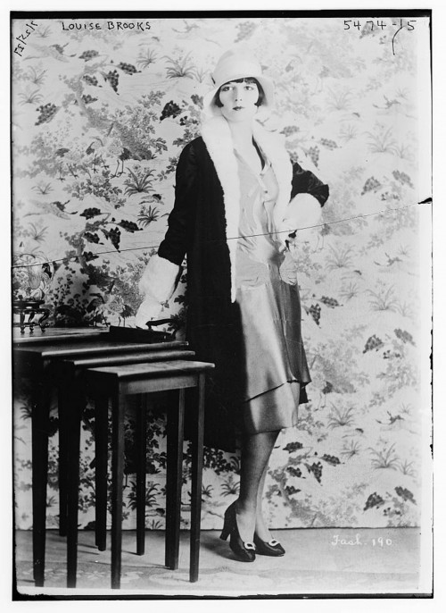 "This ""new breed"" of women – known as the flapper – went against the gender proscriptions of the era, bobbing their hair, wearing short dresses, listening to jazz, and flouting social and sexual norms. While liberating in many ways, these behaviors also reinforced stereotypes of female carelessness and obsessive consumerism that would continue throughout the twentieth century. Bain News Service, ""Louise Brooks,"" undated. Library of Congress, http://www.loc.gov/pictures/item/ggb2006007866/."