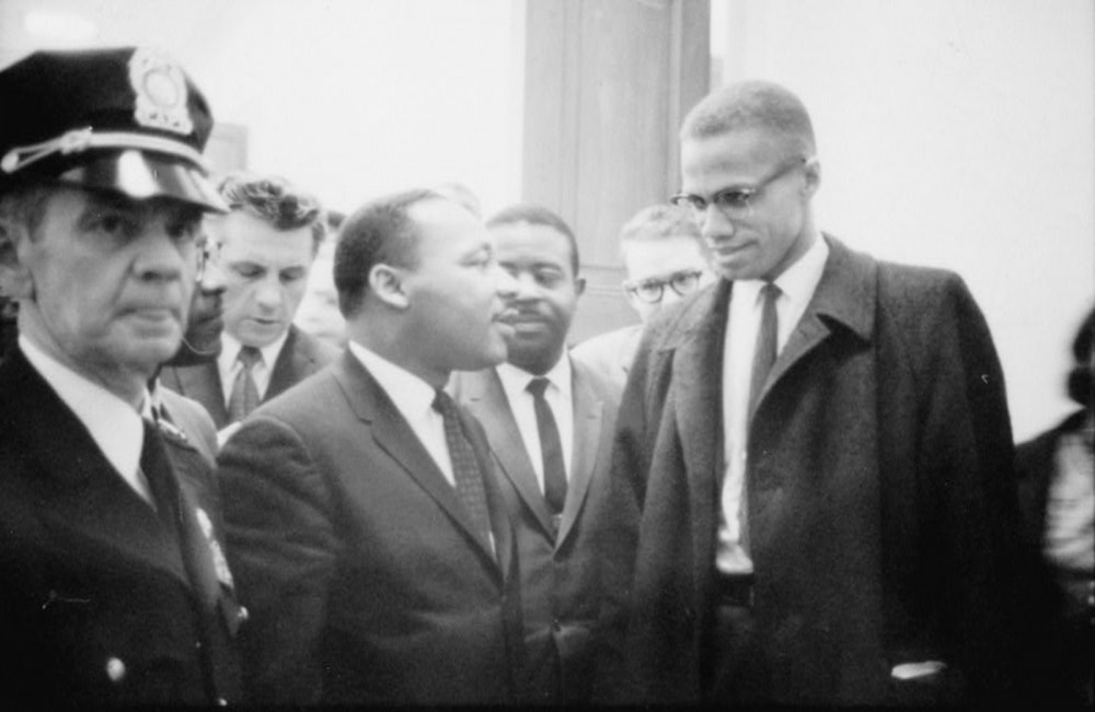 "Like Booker T. Washington and W.E.B. Du Bois before them, Martin Luther King, Jr., and Malcolm X represented two styles of racial uplift while maintaining the same general goal of ending racial discrimination. How they would get to that goal is where the men diverged. Marion S. Trikosko, ""[Martin Luther King and Malcolm X waiting for press conference],"" March 26, 1964. Library of Congress, http://www.loc.gov/pictures/item/92522562/."