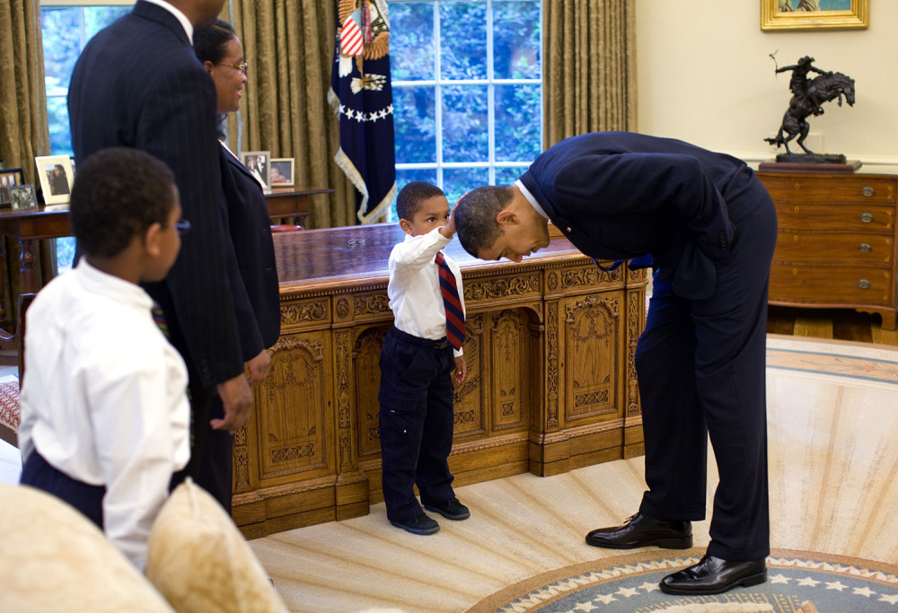 """Photograph of 5-year-old Jacob Philadelphia touching President Barack Obama's hair. The child said, """"I want to know if my hair is just like yours."""""""