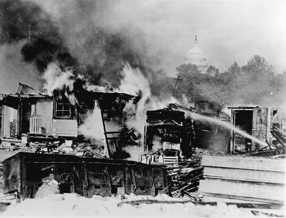 """Shacks, put up by the Bonus Army on the Anacostia flats, Washington, D.C., burning after the battle with the military. The Capitol in the background. 1932."" Wikimedia, http://commons.wikimedia.org/wiki/File:Evictbonusarmy.jpg."