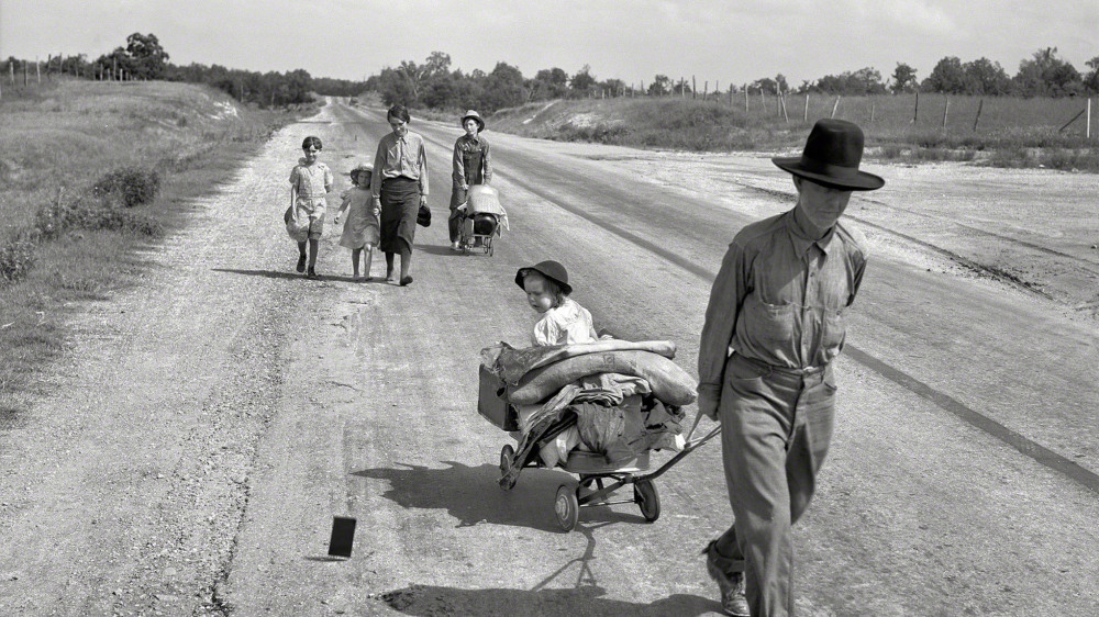 "During her assignment as a photographer for the Works Progress Administration (WPA), Dorothea Lange documented the movement of migrant families forced from their homes by drought and economic depression. This family was in the process of traveling 124 miles by foot, across Oklahoma, because the father was unable to receive relief or WPA work of his own due to an illness. Dorothea Lange, ""Family walking on highway, five children"" (June 1938) Works Progress Administration, Library of Congress."