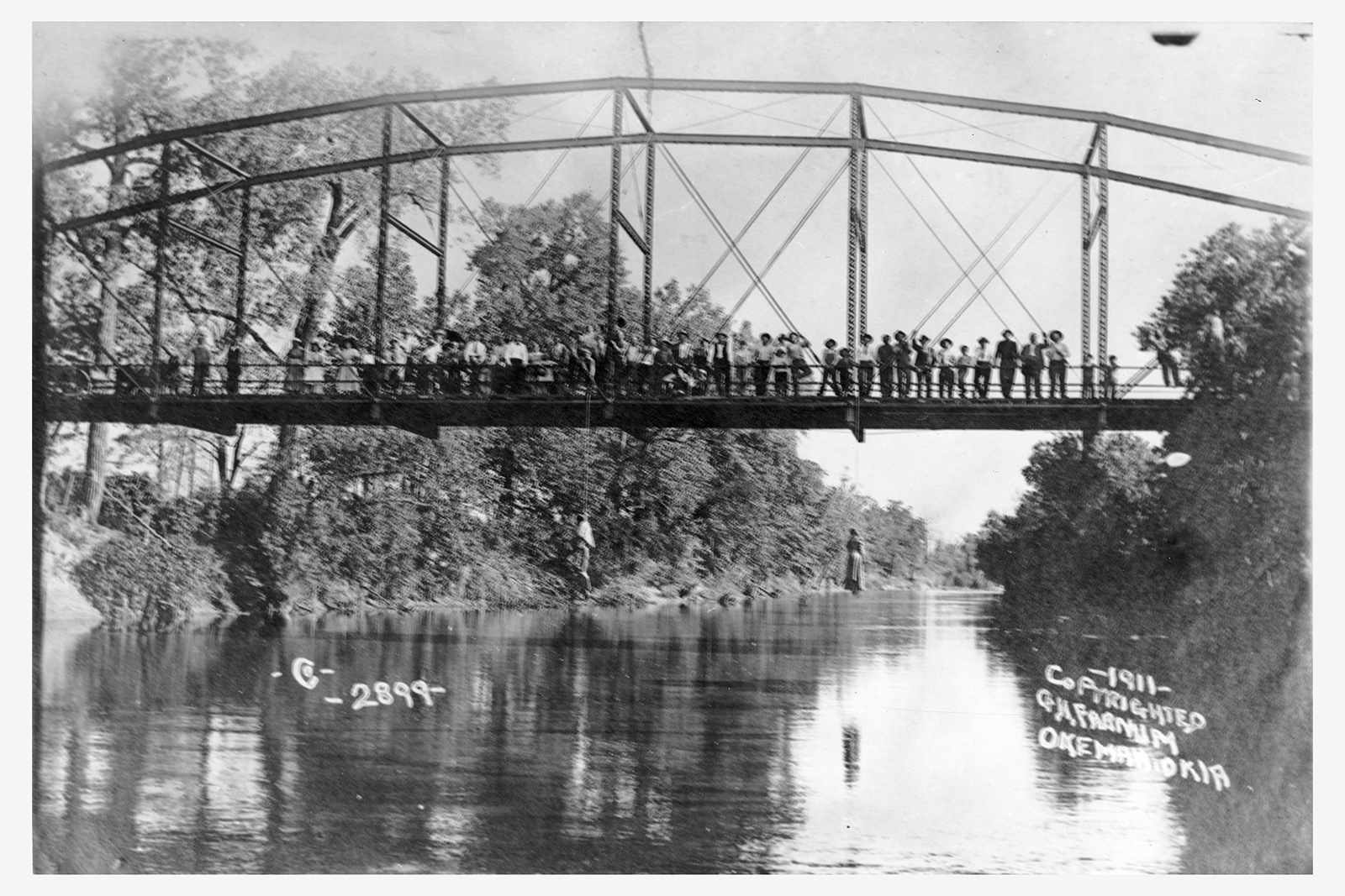 "This photograph shows the lynching of Laura and Lawrence Nelson on May 25, 1911 in Okemah, Oklahoma. One of thousands of lynchings throughout the South in the late nineteenth and century twentieth centuries, this particular case of the lynching of a mother and son garnered national attention. In response, the local white newspaper in Okemah simply wrote, ""while the general sentiment is adverse to the method, it is generally thought that the negroes got what would have been due them under due process of law."" (The Okemah Ledger, May 4, 1911) George H. Farnum (photographer), Photograph, May 25, 1911. Wikimedia, http://commons.wikimedia.org/wiki/File:Lynching_of_Laura_Nelson_and_her_son_2.jpg."