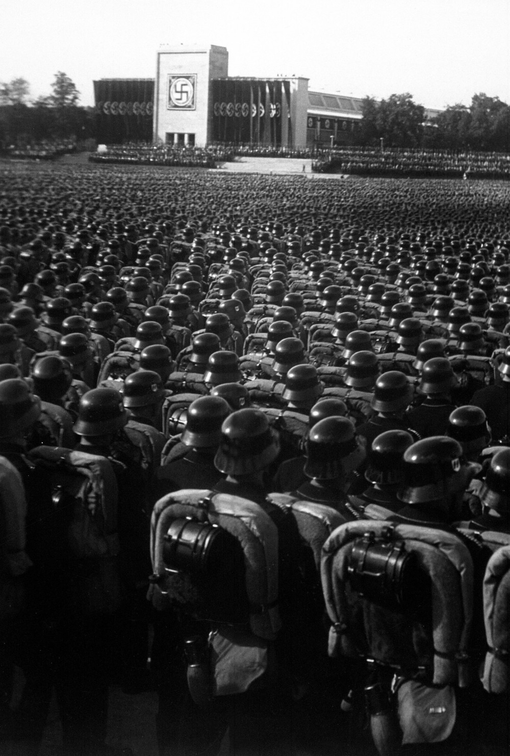 Huge rallies like this one in Nuremberg displayed the sheer number of armed and ready troop and instilled a fierce loyalty to (or fearful silence about) Hitler and the National Socialist Party in Germany. Photograph, November, 9. 1935. Wikimedia, http://commons.wikimedia.org/wiki/File:Reichsparteitag_1935.jpg.