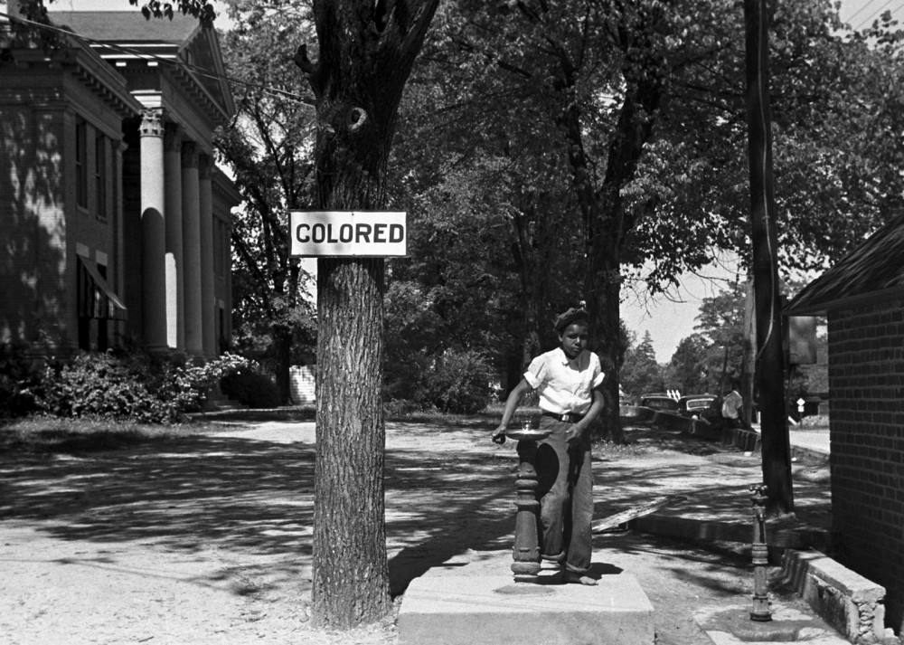 Segregation extended beyond private business property; this segregated drinking fountain was located on the ground of the Halifax county courthouse in North Carolina. Photograph, April 1938. Wikimedia, http://commons.wikimedia.org/wiki/File:Segregation_1938b.jpg.