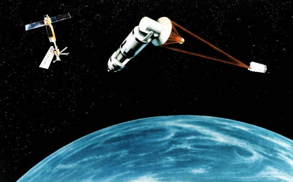"President Reagan proposed space- and ground-based systems to protect the United States from nuclear missiles in his 1984 Strategic Defense Initiative (SDI). Scientists argued it was unrealistic or impossible with contemporary technology, and it was lambasted in the media as ""Star Wars."" Indeed, as this artist's representation of SDI shows, it was rather ridiculous. Created October 18, 1984. Wikimedia, http://commons.wikimedia.org/wiki/File:Space_Laser_Satellite_Defense_System_Concept.jpg."