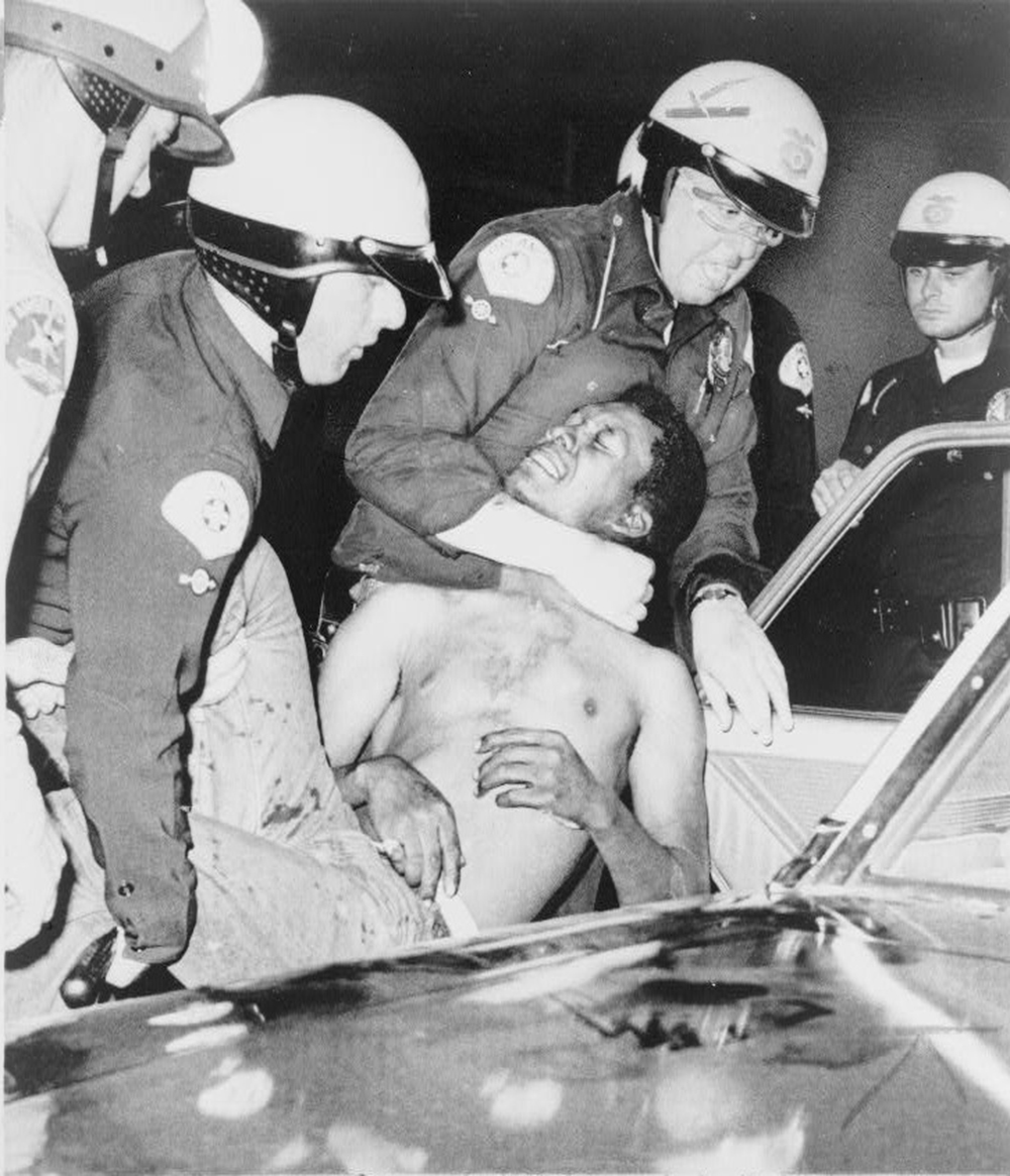 A photograph of Los Angeles police violently arresting a Black man during the Watts riot onAugust 12, 1965