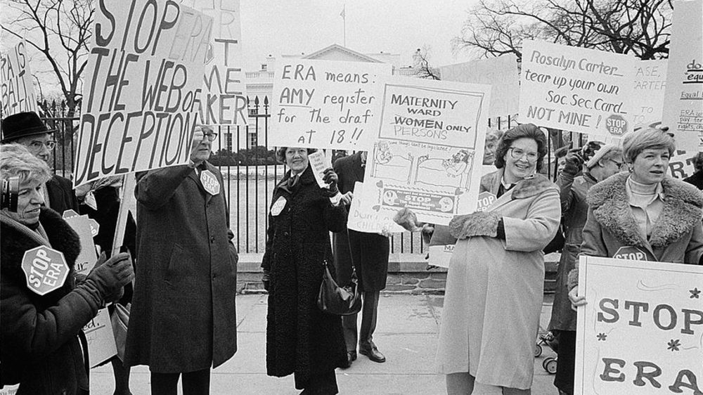 """In the 1970s, conservative Americans defeated the Equal Rights Amendment (ERA). With high approval ratings, the ERA--which declared, """"Equality of rights under the law shall not be denied or abridged by the United States or any state on account of sex""""—seemed destined to pass swiftly through state legislatures and become the Twenty-Seventh Amendment, but conservative opposition stopped the Amendment just short of ratification. Warren K. Leffler, Demonstrators opposed to the ERA in front of the White House, 1977, via Library of Congress."""