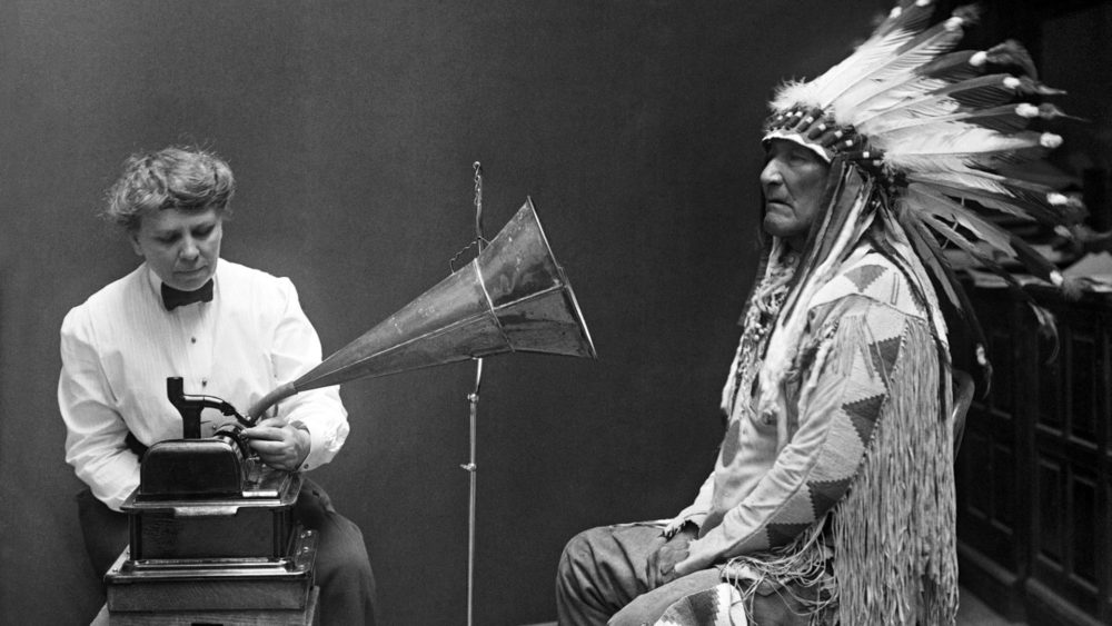 American anthropologist and ethnographer Frances Densmore records the Blackfoot chief Mountain Chief in 1916 for the Bureau of American Ethnology.
