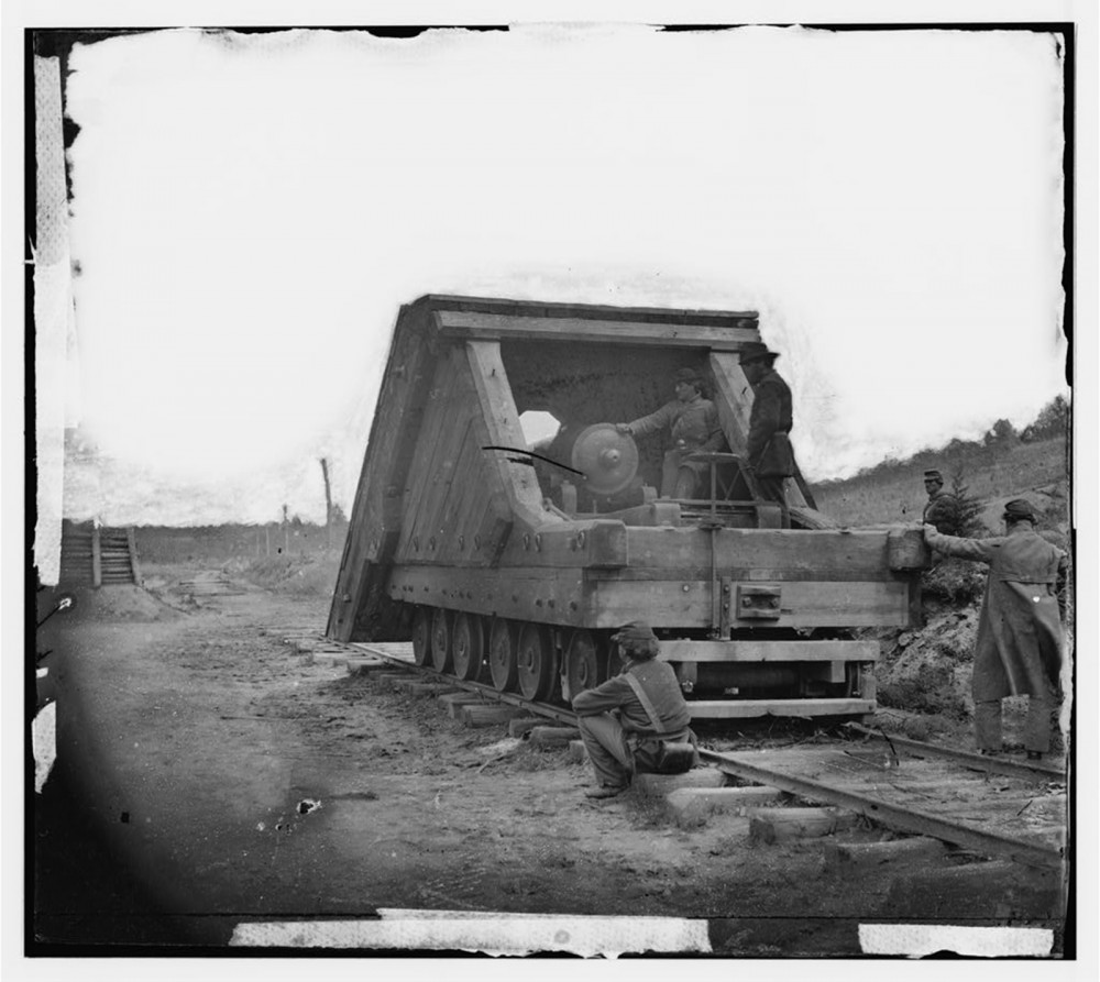 """New and more destructive warfare technology emerged during this time that utilized discoveries and innovations in other areas of life, like transportation. This photograph shows Robert E. Lee's railroad gun and crew used in the main eastern theater of war at the siege of Petersburg, June 1864-April 1865. """"Petersburg, Va. Railroad gun and crew,"""" between 1864 and 1865. Library of Congress, http://www.loc.gov/pictures/item/cwp2003000572/PP/."""