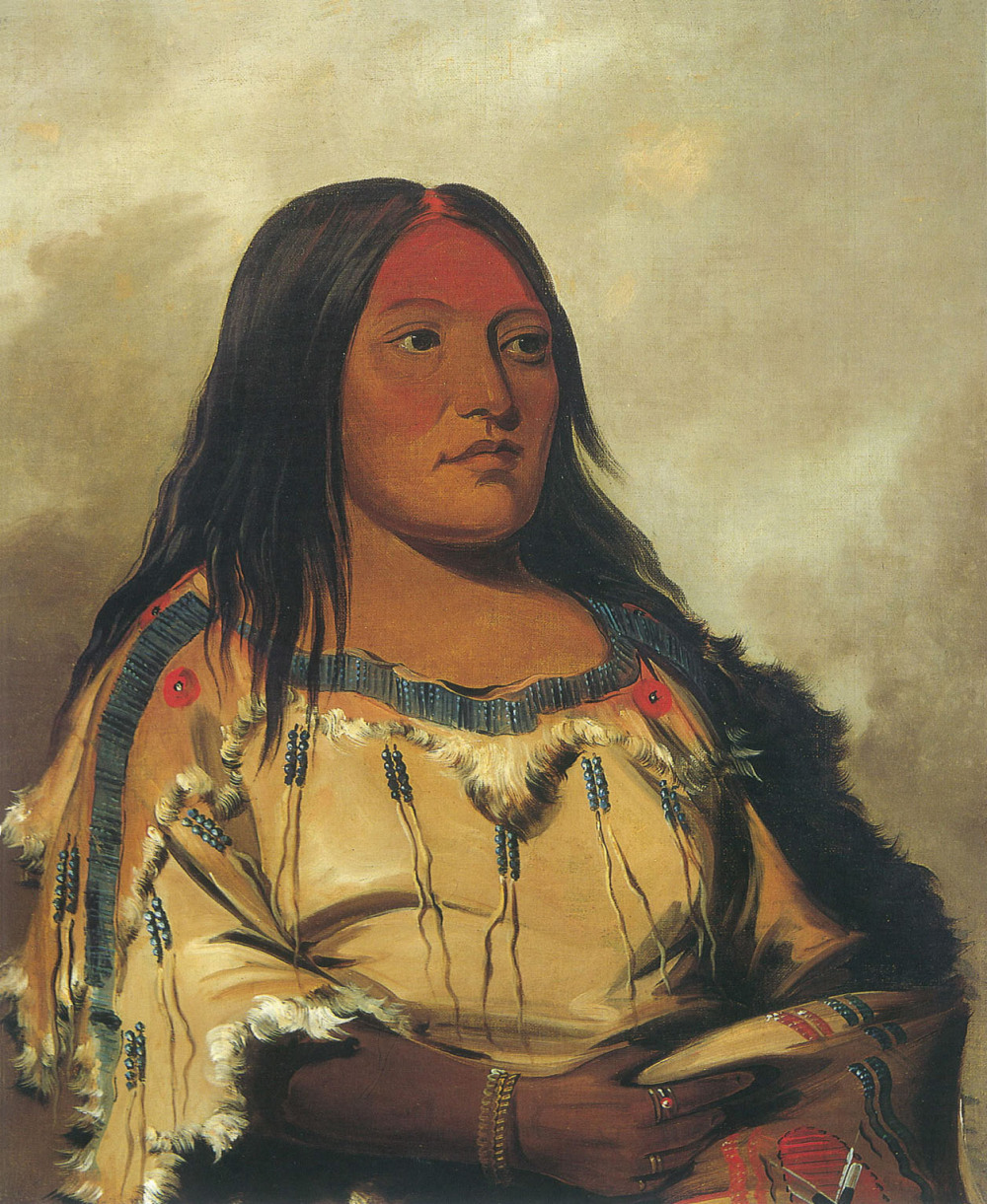 American artist George Catlin traveled west to paint Native Americans. In 1832 he painted Eeh-nís-kim, Crystal Stone, wife of a Blackfoot leader. Via Smithsonian American Art Museum.