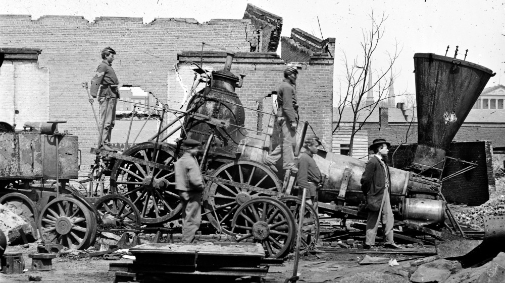 "War brought destruction across the South. Governmental and private buildings, communication systems, the economy, and transportation infrastructure were all debilitated. ""[Richmond, Va. Crippled locomotive, Richmond & Petersburg Railroad depot],"" c. 1865. Library of Congress."