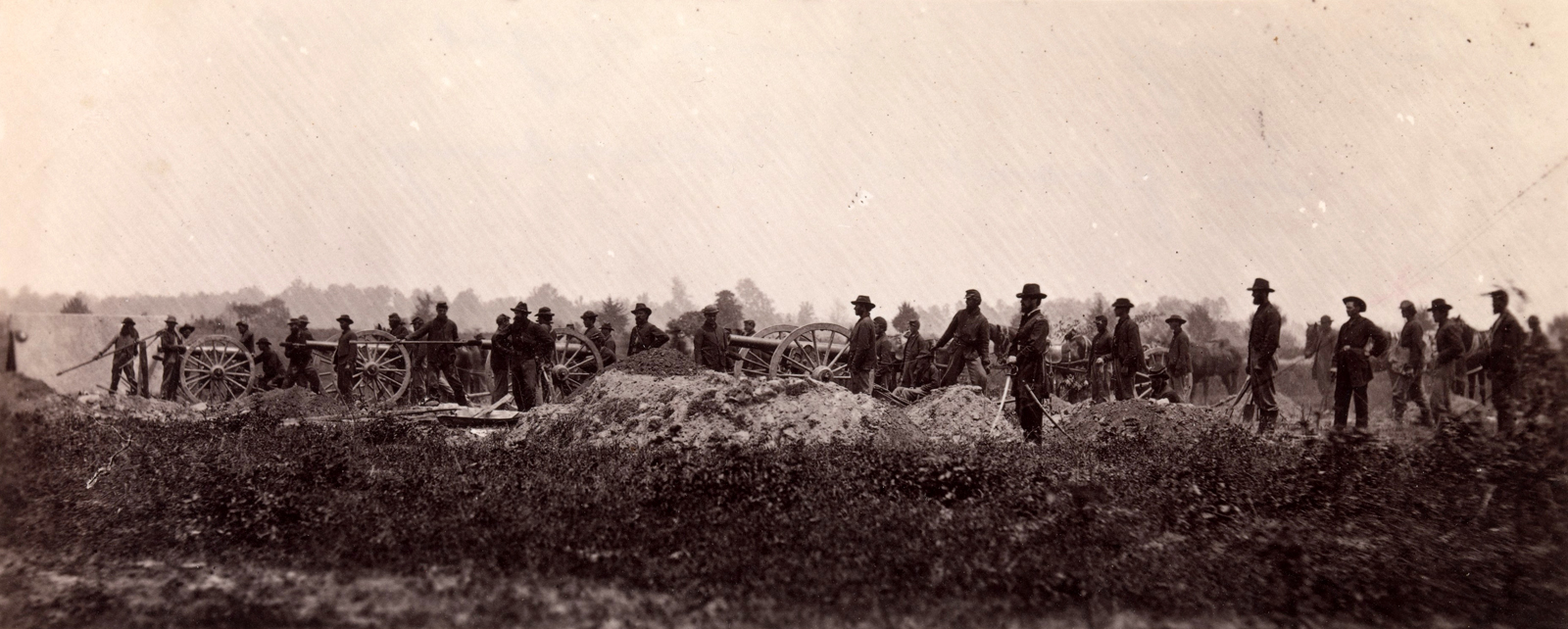 This photograph shows the men and cannons of the Pennsylvania Light Artillery, in 1864.