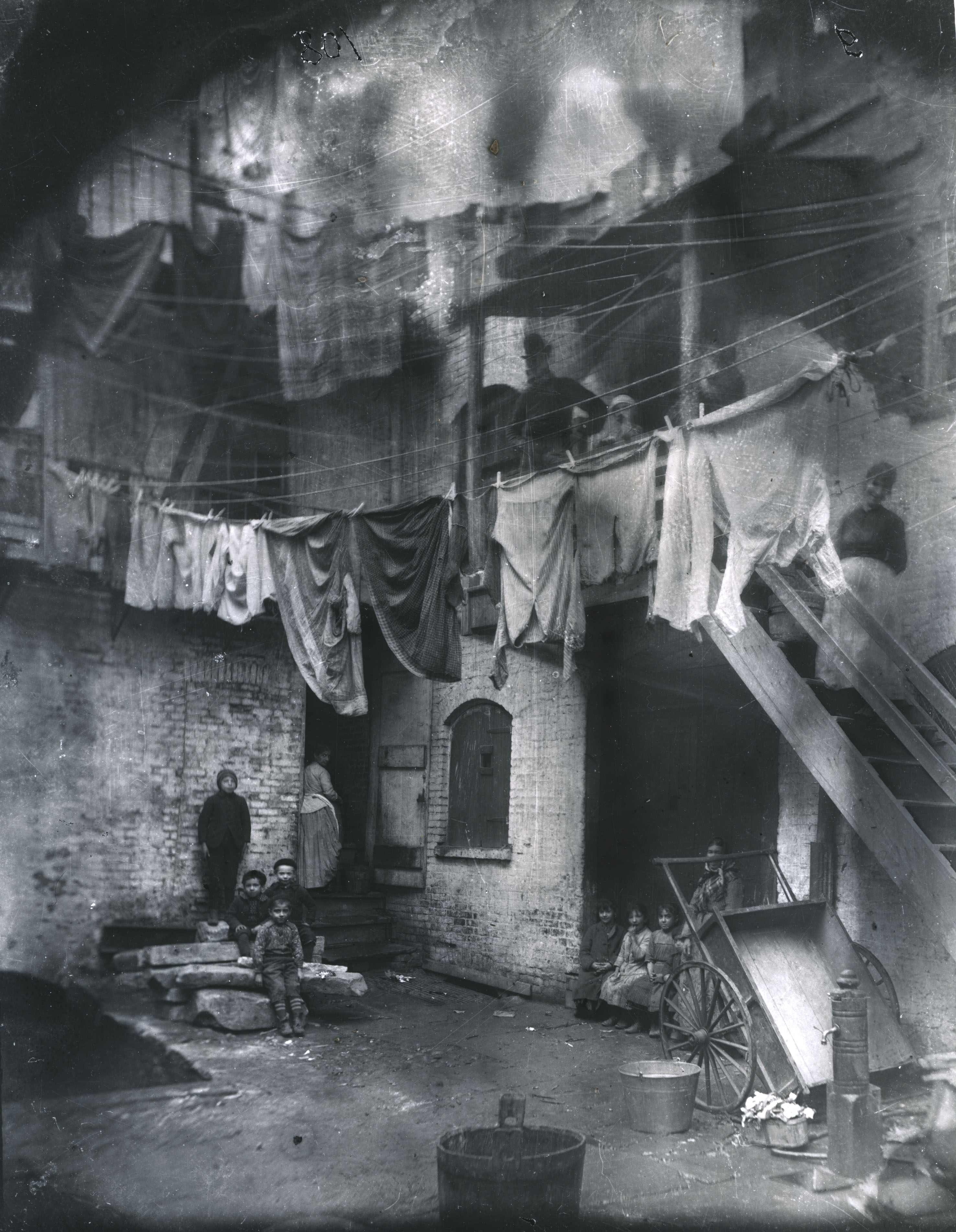 Tenement Yard, How the Other Half Lives. Via Preus Museum