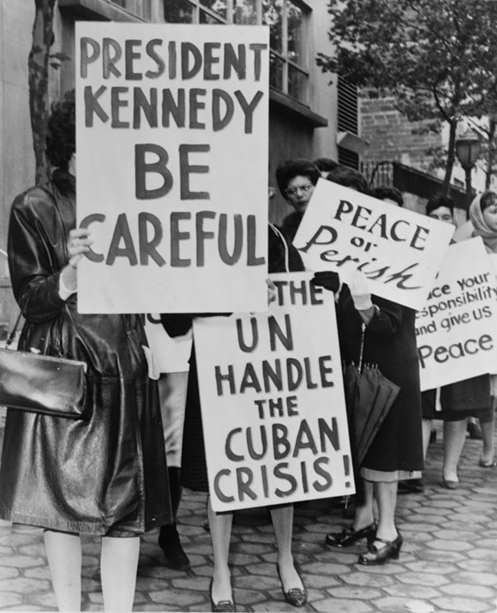 "The Cuban Missile Crisis was a time of great fear throughout America. Women in this photograph urged President Kennedy to be cautious of instigating war. Phil Stanziola, ""800 women strikers for peace on 47 St near the UN Bldg,"" 1962. Library of Congress, http://www.loc.gov/pictures/item/2001696167/."