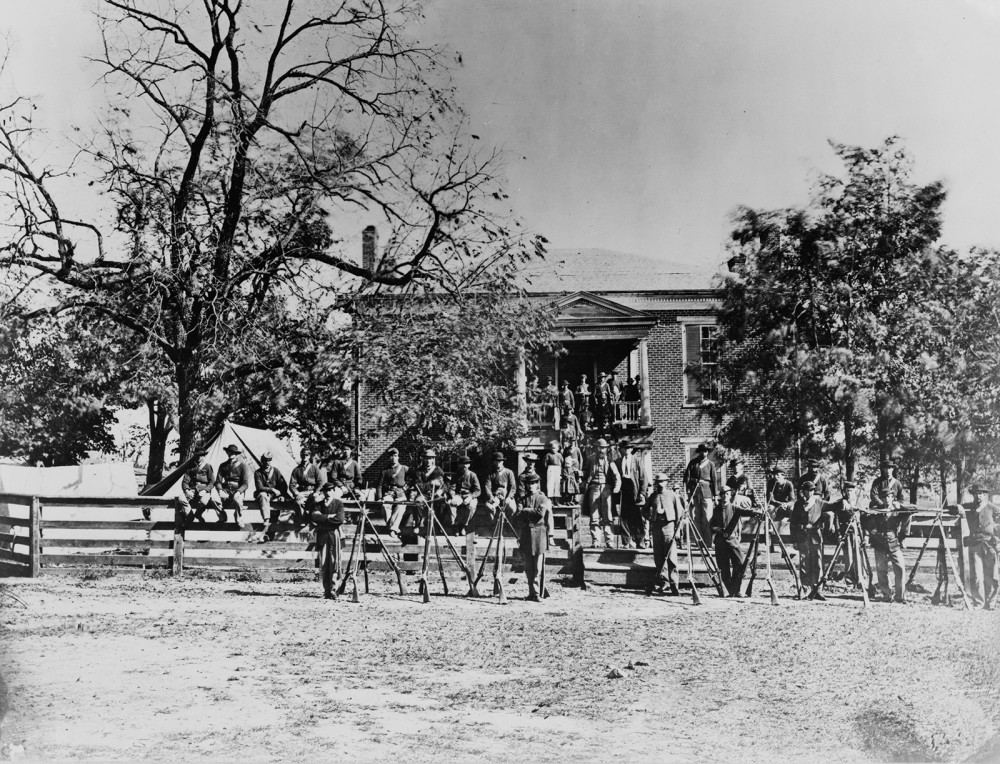 Unions soldiers pose in front of the Appomattox Court House after Lee's surrender in April 1865. Wikimedia, http://commons.wikimedia.org/wiki/File:Appomattox_Court_House_Union_soldiers.jpg.