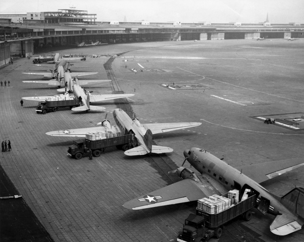The Berlin Blockade and resultant Allied airlift was one of the first major crises of the Cold War. Photograph, U.S. Navy Douglas R4D and U.S. Air Force C-47 aircraft unload at Tempelhof Airport during the Berlin Airlift, c. 1948-1949. Wikimedia, http://commons.wikimedia.org/wiki/File:C-47s_at_Tempelhof_Airport_Berlin_1948.jpg.