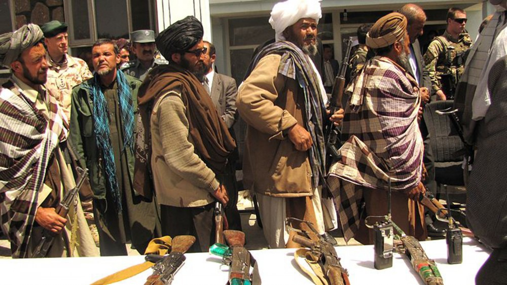 Photograph of former Taliban fighters surrendered their arms to the government of the Islamic Republic of Afghanistan during a reintegration ceremony.
