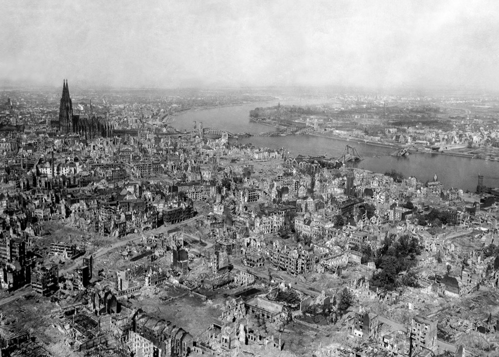 Bombings throughout Europe caused complete devastation in some areas, leveling beautiful ancient cities like Cologne, Germany. Cologne experienced an astonishing 262 separate air raids by Allied forces, leaving the city in ruins as in these the photograph above. Amazingly, the Cologne Cathedral stands nearly undamaged even after being hit numerous times, while the area around it crumbles. Photograph, April 24, 1945. Wikimedia, http://commons.wikimedia.org/wiki/File:Koeln_1945.jpg.