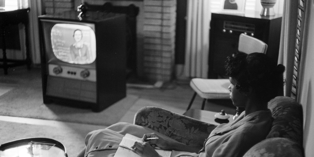 """Photograph shows an African American high school girl being educated via television during the period that the Little Rock schools were closed to avoid integration."" 1958. Photograph by Thomas J. O'Halloran. Library of Congress (LC-U9- 1525F-28)."