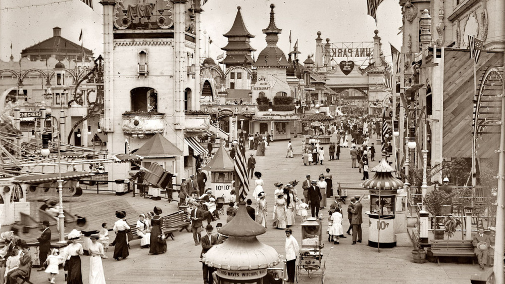Amusement-hungry Americans flocked to new entertainments at the turn of the twentieth century. In this early-twentieth century photograph, visitors enjoy Luna Park, one of the original amusement parks on Brooklyn's famous Coney Island. Visitors to Coney Island's Luna Park, ca.1910-1915. Via Library of Congress (LC-B2- 2240-13).