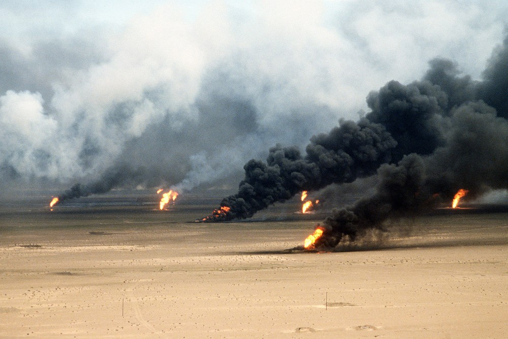 The Iraqi military set fire to Kuwait's oil fields during the Gulf War, many of which burned for months and caused massive pollution. Photograph of oil well fires outside Kuwait City, March 21, 1991. Wikimedia, http://commons.wikimedia.org/wiki/File:Operation_Desert_Storm_22.jpg.
