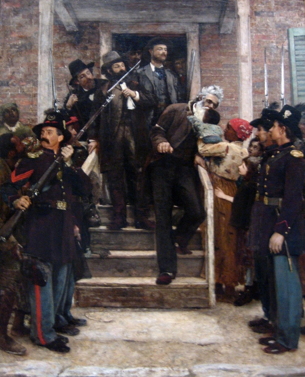 The execution of John Brown made him a martyr in abolitionist circles and a confirmed traitor in southern crowds. Both of these images continued to pervade public memory after the Civil War, but in the North especially (where so many soldiers had died to help end slavery) his name was admired. Over two decades after Brown's death, Thomas Hovenden portrayed Brown as a saint. As he is lead to his execution for attempting to destroy slavery, Brown poignantly leans over a rail to kiss a black baby. Thomas Hovenden, The Last Moments of John Brown, c. 1882-1884. Wikimedia, http://commons.wikimedia.org/wiki/File:%27The_Last_Moments_of_John_Brown%27,_oil_on_canvas_painting_by_Thomas_Hovenden.jpg.