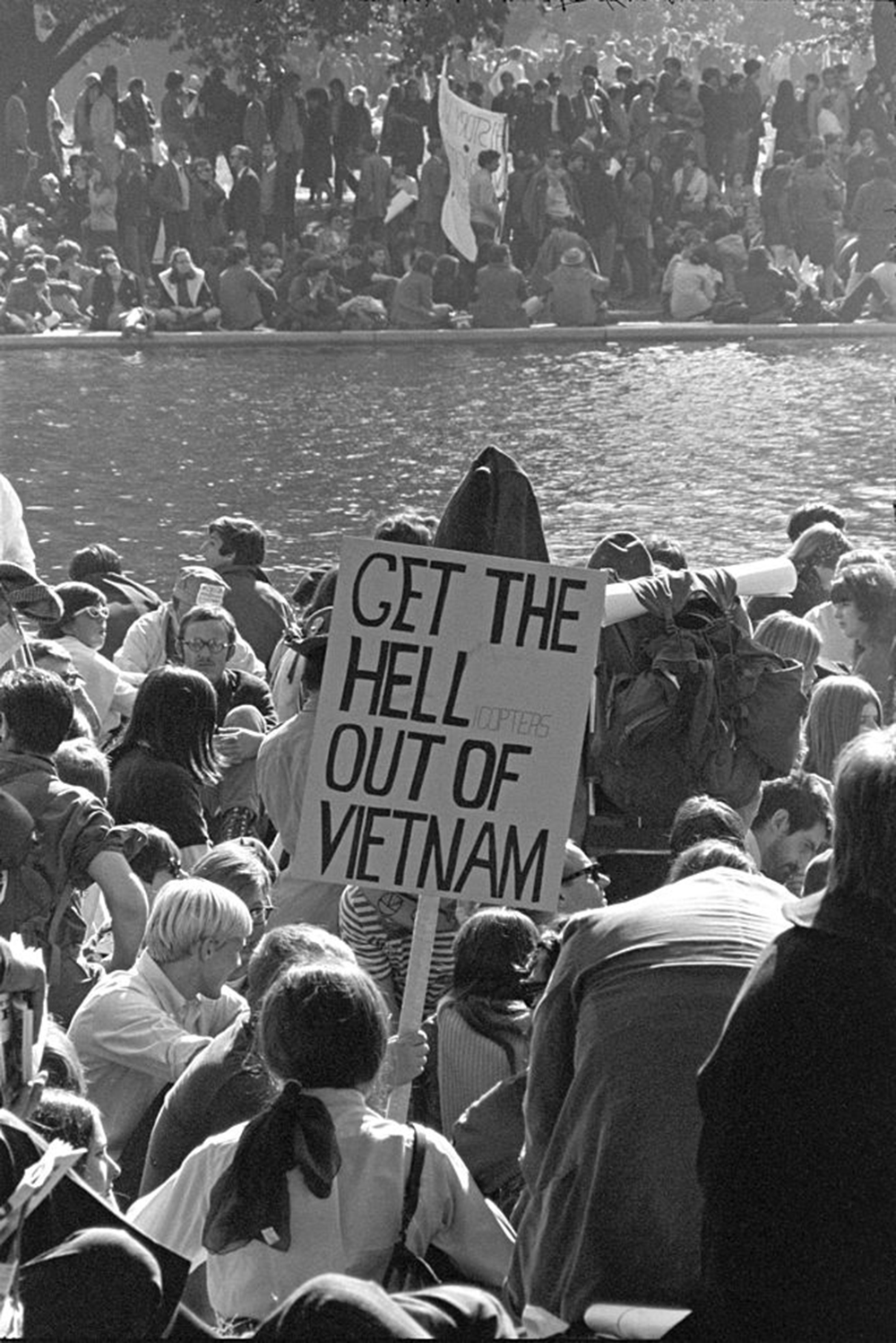 """Photograph of Vietnam War protestors in Washington DC. A sign says """"Get the Hell out of Vietnam!"""""""