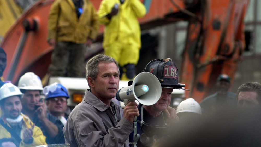 President Bush addresses rescue workers at Ground Zero of the World Trade Center disaster. Thomas R. Roberts, New York, NY, September 14, 2001. Via FEMA Photo Library.